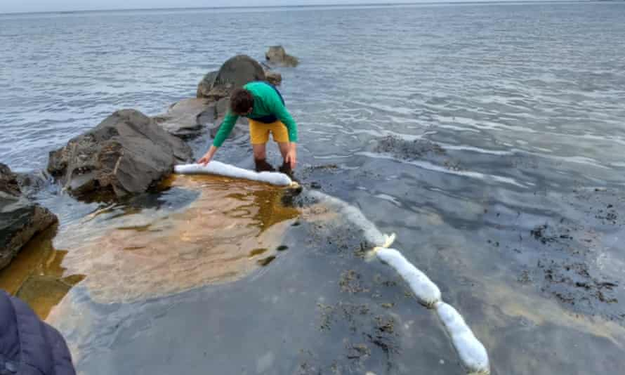 Hair-booms being used to prevent an oil spill from spreading.