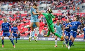 Manchester City's Carli Lloyd heads in their third goal.