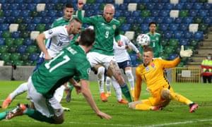 Slovakia's Milan Skriniar (left) scores an own goal .