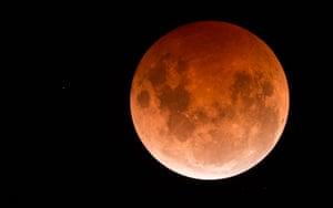 The moon has taken on an orange hue.