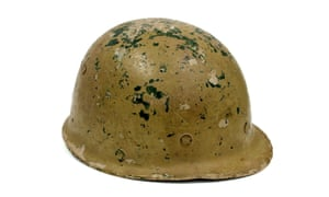 Iraqi military M80 Helmet made from painted layers of compressed canvas. M80 helmets were usually supplied in a dark green colour and then overpainted in a desert tan that had a tendency to flake off. This example was given to the archive by Guardian foreign correspondent Luke Harding, who also gave an oral history describing his experiences reporting on the Iraq war. (GNM Archive ref: 2003/091)