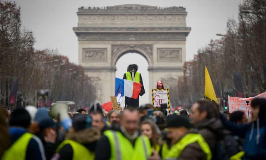 Yellow vest protestors near the Arc de Triomphe in Paris, France.