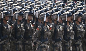 Chinese soldiers take part in a parade commemorating the 70th anniversary of Japan's surrender. Beijing intends to increase its defence budget by up to 8% according to a senior official.