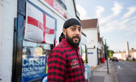 Kam Singh Nijjar outside his newsagent in Meriden