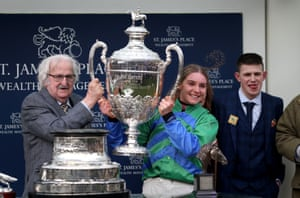 Maxine O'Sullivan celebrates with the massive trophy after It Came to Pass won The Foxhunters Chase.