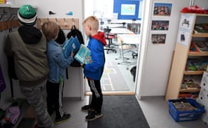 Pupils get ready to start a lesson at the Lauttasaari primary school in Helsinki.