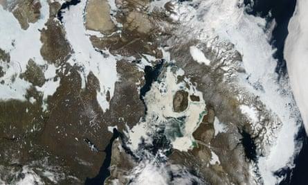 A Nasa image shows receding ice cover over northern Canada.