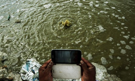 ndians take pictures of contaminated water at the Vijyaipura landfill near Bangalore