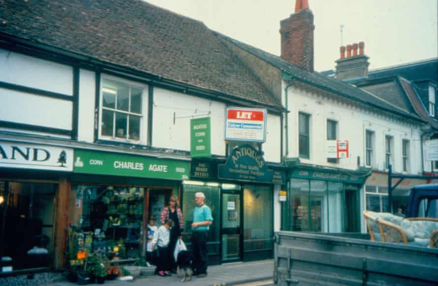 A range of shops in East Street, Horsham, where Annabelle Hughes found clues to the buildings' history lying underneath the shop front and roof, and discovered through deeds that the site had been owned by a monk bailiff of Fecamp Abbey in the late 12th and early 13th century.