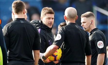 Mauricio Pochettino was furious with the referee Mike Dean (centre) but later backtracked.