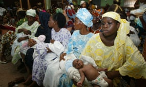 Women and babies wait in a medical centre in Nigeria