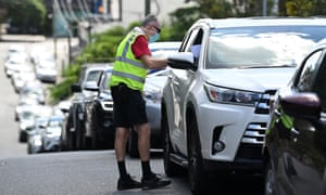 Vehicles queue for Covid testing at a clinic in Bowen Hills, Brisbane