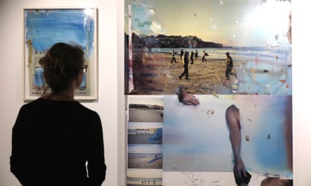 A patron looking at Rob Cleworth's artwork which explores the police shooting of Roni Levi on Bondi beach, showing as part of the justiceINjustice exhibition – a collaboration between artists and lawyers.