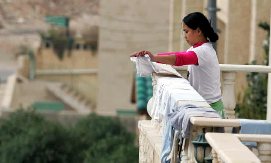 A maid from the Philippines on the balcony of her employer's house in Amman, Jordan, in 2008.