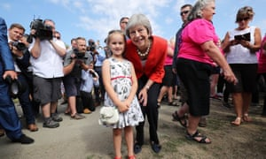 Theresa May with Anest Jones, 6, from the Brecon Beacons.