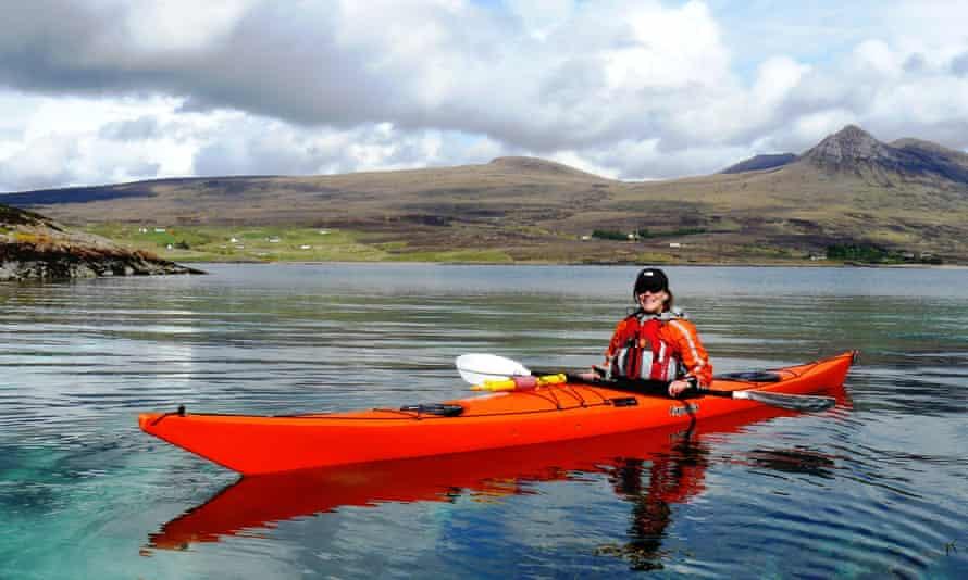 Women in kayak on Scottish loch