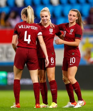 Alex Greenwood of England celebrates with Leah Williamson and Ella Toone after scoring their side's fifth goal.