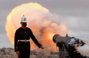 Uniformed man fires cannon