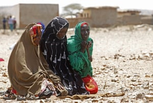 Women pray as they wait for assistance in Hariirad town, Awdal region. In Somaliland and the Puntland region, 1.7 million people are in need of aid, according to the UN