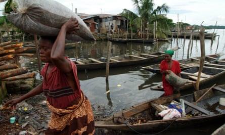 Women return from fishing in Buguma, in the Niger Delta area of Nigeria
