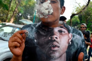 Mexico City, Mexico A man smokes a joint during a rally in support of the legalization of marijuana, at the La Ciudadela Park