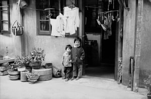Two children outside a house in Beijing in 1979. After food shortages in the 1970s spurred fears of another famine, the government introduced a policy requiring Han Chinese, the majority ethnic group, to have no more than one child.