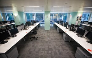 Empty desks stand at Cushman & Wakefield Plc