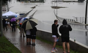 Onlookers watch the submerged New Windsor Bridge at Windsor in the north west of Sydney, Australia, 22 March 2021.