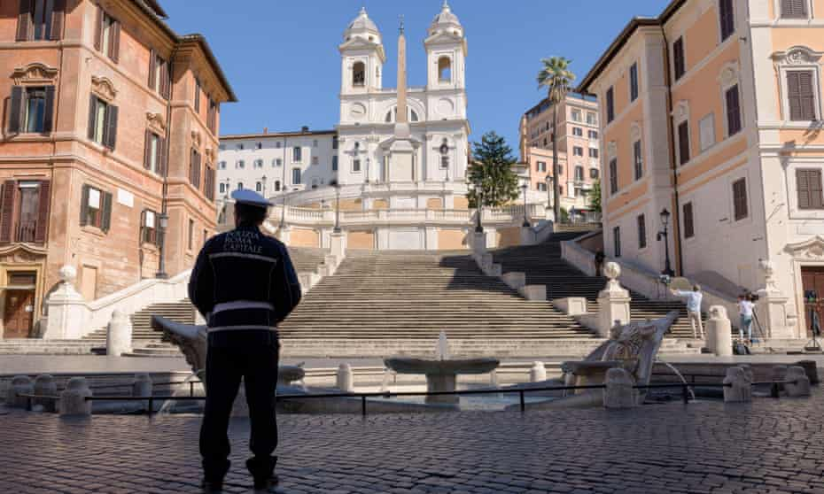 A police officer stands in front of the Spanish Steps in Rome, in March 2020 shortly after a national lockdown was imposed.