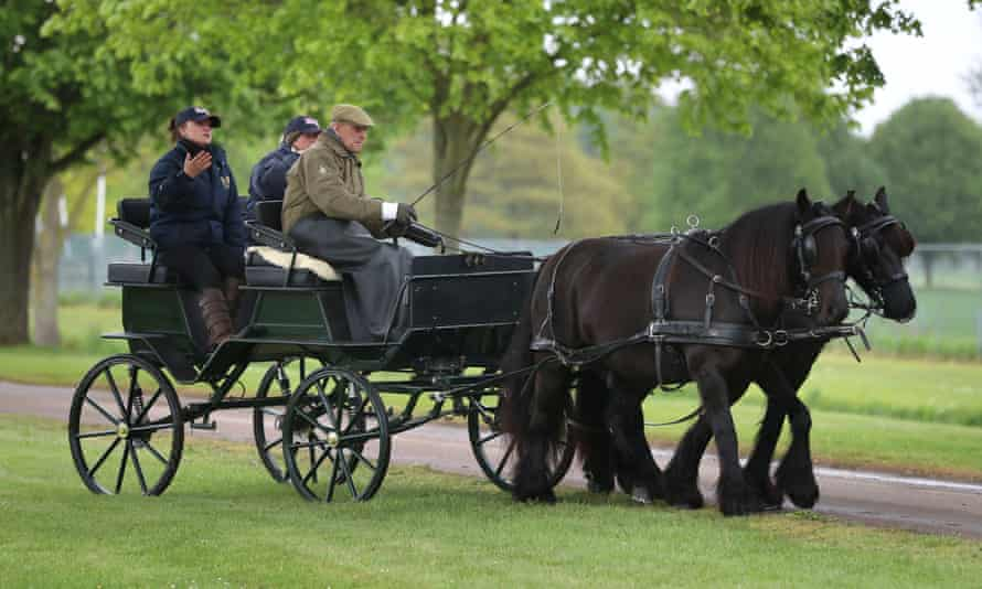 Prince Philip driving his carriage at the Royal Windsor horse show in May 2019