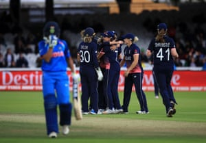 Hartley celebrates the wicket of Verma with teammates.