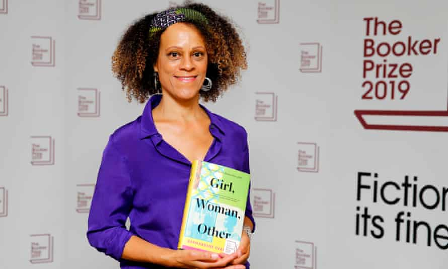 British author Bernardine Evaristo poses with her book Girl, Woman, Other.