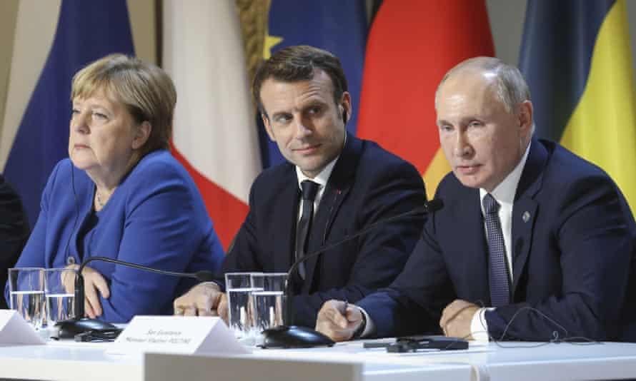 Angela Merkel, Emmanuel Macron, left and centre, have sugggested an EU summit with Russian president Vladimir Putin.