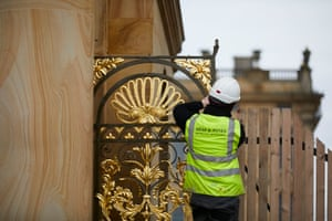 Worker and gilded gate