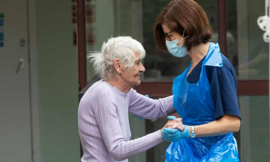 Care worker dances with older woman
