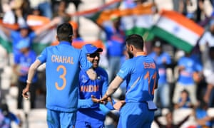 India's Mohammed Shami (right) celebrates with teammates Rohit Sharma (centre) and Yuzvendra Chahal (left) after his hat-trick and victory.