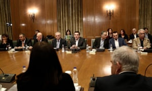 Alexis Tsipras and ministers attend a cabinet meeting at the Greek parliament in Athens