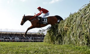 Tiger Roll races in front of a section of the Aintree crowd on his way to winning the Grand National of 2018.
