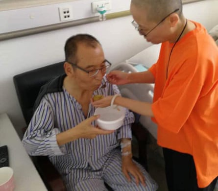 Chinese dissident Liu Xiaobo is attended to by his wife Liu Xia in a hospital in China.
