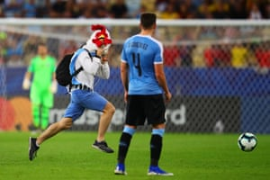 24 June 2019, Chile v Uruguay, Estadio Maracana.A pitch invader with a chicken mask invades the pitch during the game.