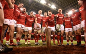 Wales squad celebrate their win.