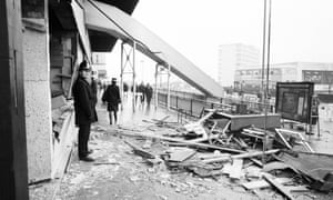 A policeman standing outside the Mulberry Bush the day after the explosion in Birmingham City centre.