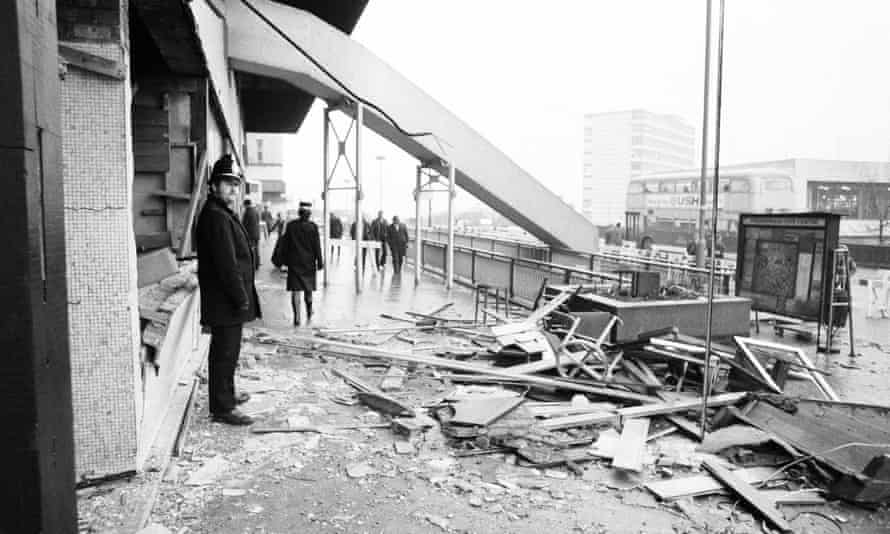 Police stationed outside the remains of the Mulberry Bush pub in Birmingham, after it was bombed in November 1974.