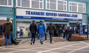 Fans approaching the main entrance at Tranmere's ground.