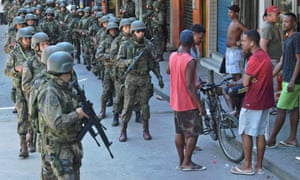 Police personnel in combat gear are seen at Rocinha favela in Rio de Janeiro