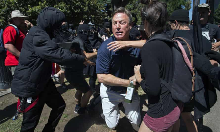 KCRA television reporter Mike Luery runs away from members of Antifa Sacramento, who staged a counter-protest against the Traditionalist Worker party and the Golden State Skinheads, in Sacramento, California on 26 June 2016.