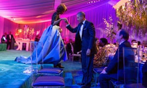 Helping Michelle off the stage during the state dinner for François Hollande, 11 Feb 2014.