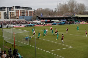 Ben Gerring's goal-bound header is saved by Heurelho Gomes in the Watford goal during a rare Woking chance