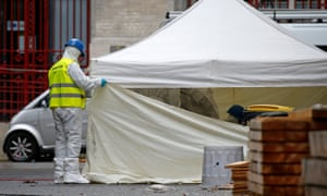 Forensics of the French police are at work outside a building in Saint-Denis, near Paris, France