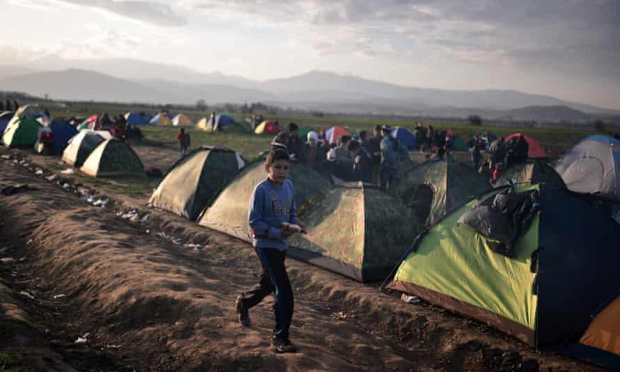 A boy carries food through the makeshift migrant camp near Idomeni on the Greek-Macedonian border.